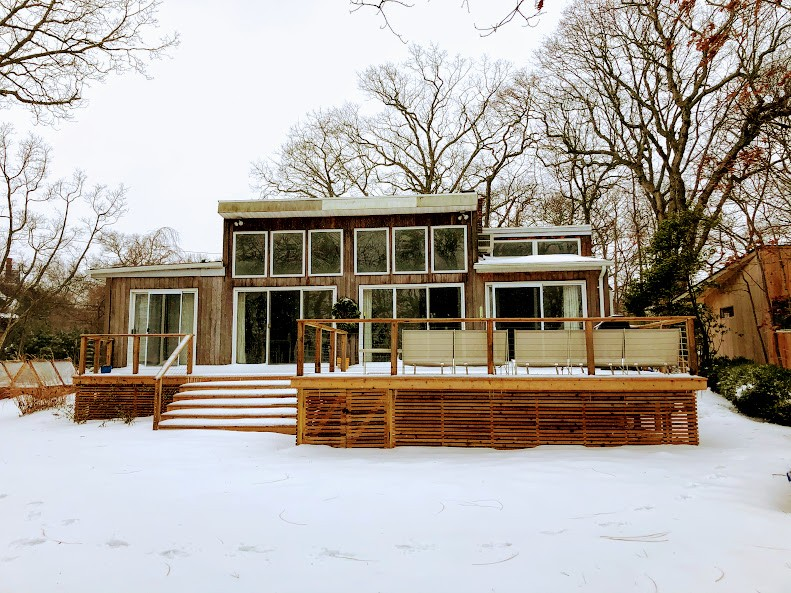 The house all covered in snow during the first snow day of the winter.