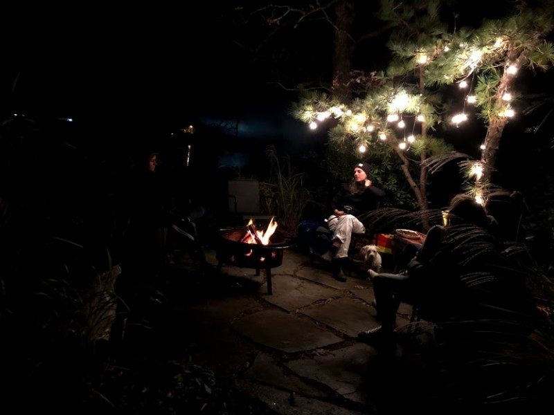 Our favorite spot on our property is the patio near the water. We gather with friends around the fire pit to grill and chat.