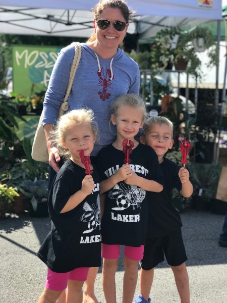 Kelly at the local farmers market with nieces and nephew