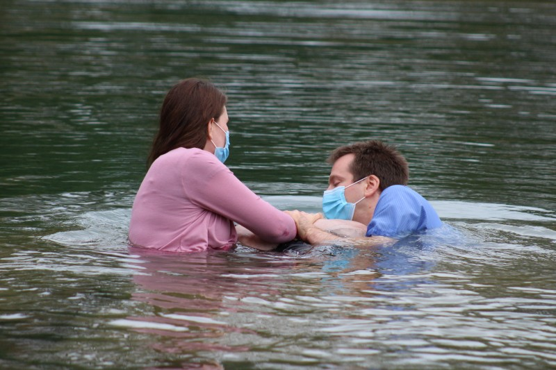 Jessica helping Jeff baptize during the pandemic