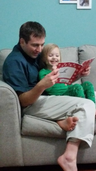 Jeff reading to a friend's child