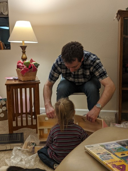 Jeff helping our niece with her doll house