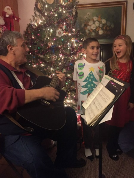 Grandpa singing with Rebecca and Lucas Christmas songs