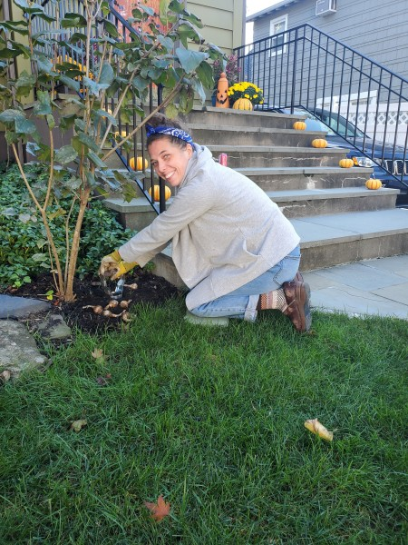 Joanna loves spending time in the garden. This is her planting bulbs for the spring