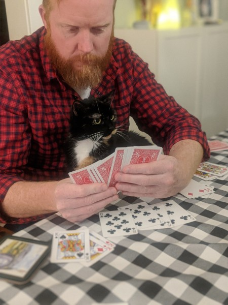 Tom and our cat, Cinder, playing Rummy-- our go to card game!