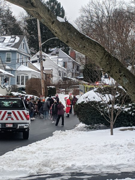 Santa visits our neighborhood every year just up the street from our house