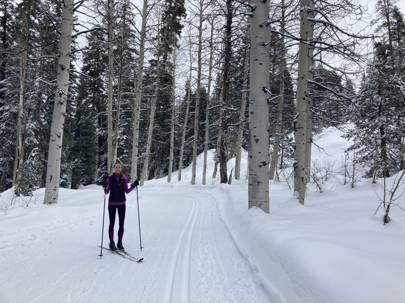 Kirsten cross country skiing in an Aspen grove with Andy near the family ranch (2021)