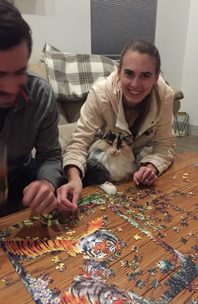 Mocha helping Kirsten and Andy with a puzzle (2019)