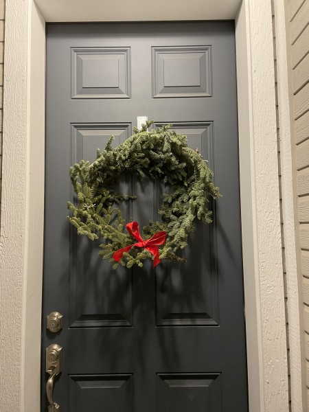 The holiday wreath Kirsten made out of leftover Christmas tree branches (2020)