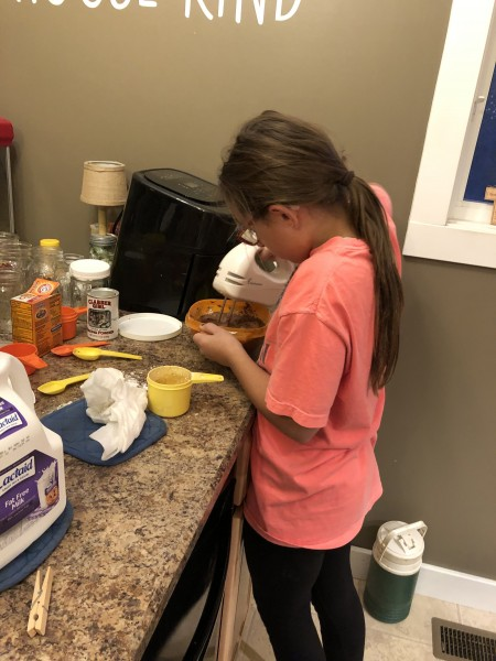 Emma baking homemade chocolate cake
