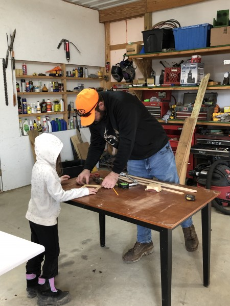 Lydia and dad building a wooden picture frame