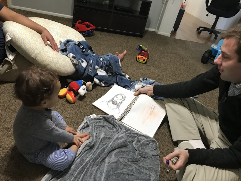 Matt drew a picture of Jesus and then Zion helped color it