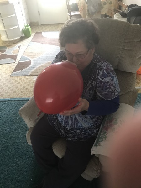 Blowing up balloons for Chelsey's si
