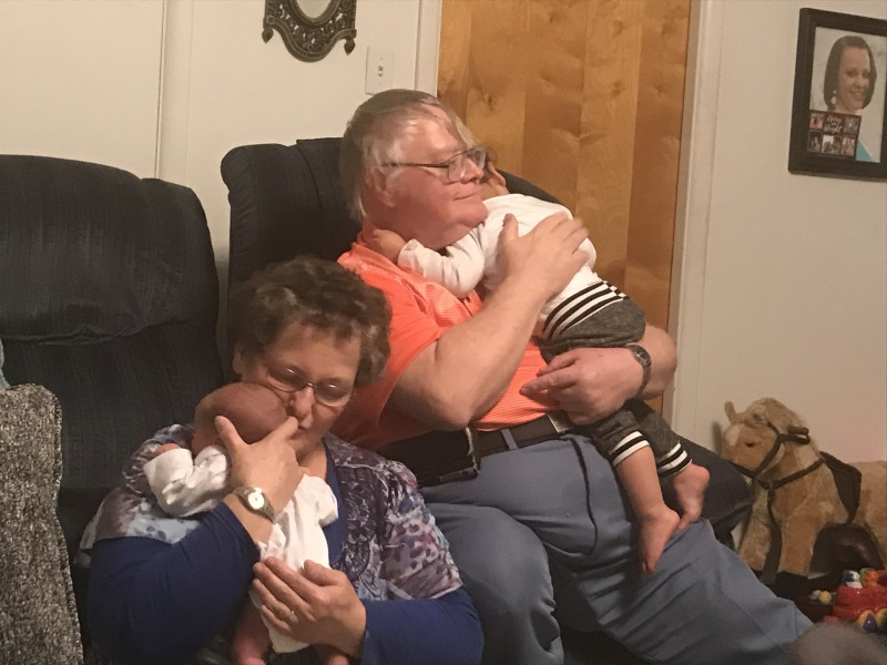 Zion and Maliko being comforted by Grandma and Grandpa