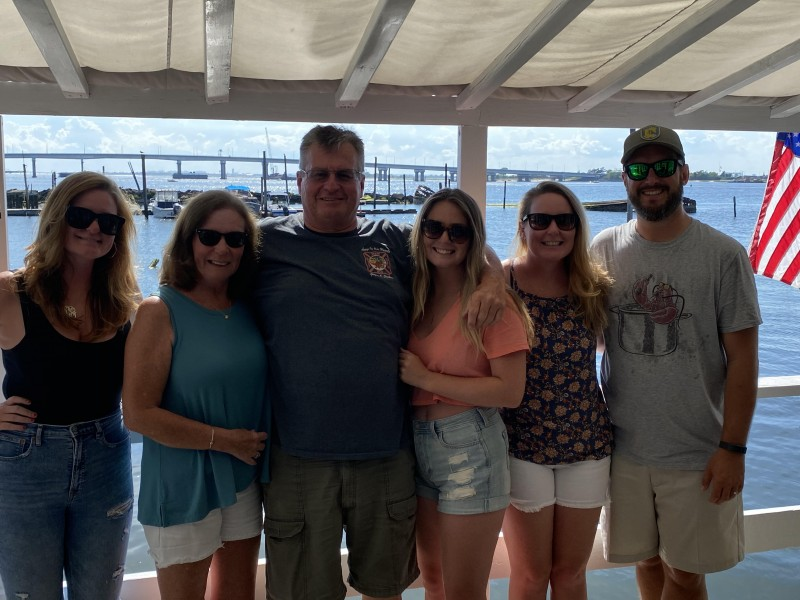 Kate and Seamus with Kate's family at the bungalow over the water