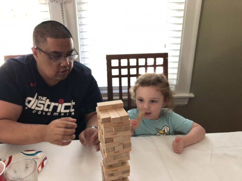 Mark practices his Jenga skills with our cousin
