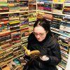 Reading in a Paris bookshop