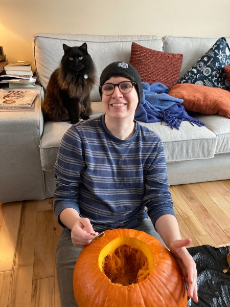 Our cats love to participate in any activity. Here is Beans 'helping' Abby carve a pumpkin.