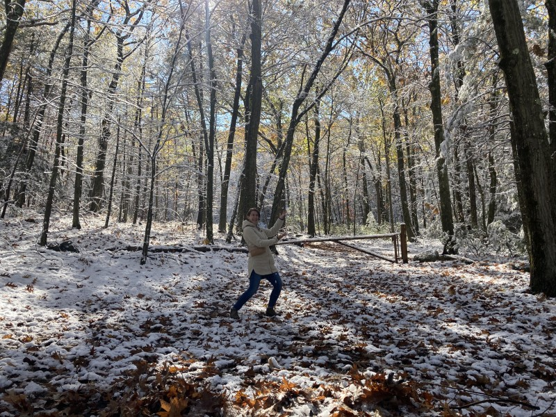 Kate exploring the same state park after the first snowfall in October.