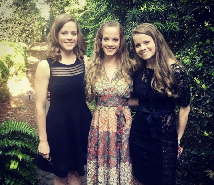 Laura with her sisters