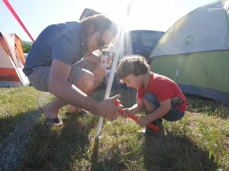 Helping hands set up camp