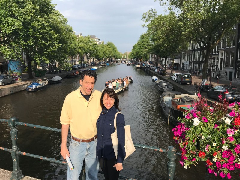 Here we are in front of a canal in Amsterdam. What an amazing trip!