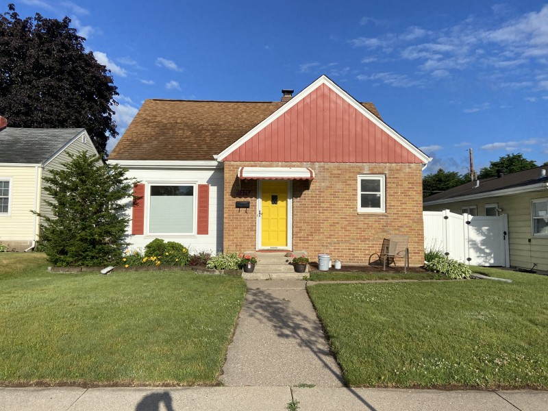 Our home after a fresh coat of paint. We were brave with the yellow door :)