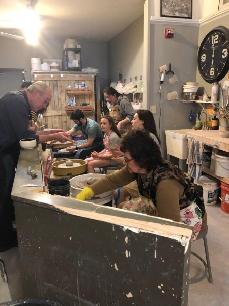 All of us doing pottery