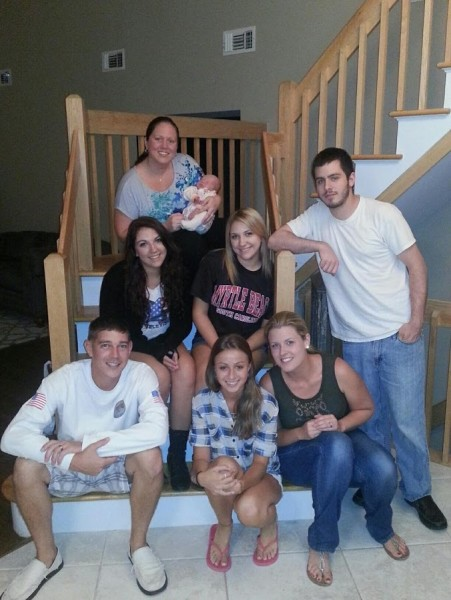 Kelly with her brother and their cousins