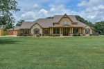 4 bdrms 3.5 baths 3 car garage 2 outbuildings.