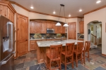 Gourmet kitchen with SS appliances and 2 pantries.