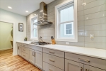 Gas range offset with oversized subway tile