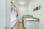 Mudroom with cubbies and laundry are includes sink