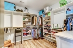 Large closet with custom shelving and storage