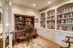 Home office with built-ins and glass doors
