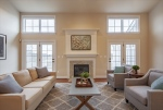Soaring ceiling and french doors let light in