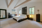 Secluded upstairs master suite with balcony.