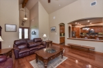 Family room with soaring ceiling and wood beam