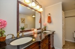 Furniture style vanity with 2 sinks.