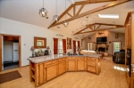 Main living area with exposed ceiling trusses.
