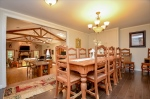 Large dining room with wall cabinet storage