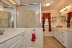 Full bath with 2 vanities and walk-in shower.