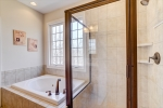 Owners bath with soaking tub and walk in shower