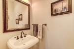 Main level powder room with pedestal sink