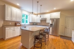 Recently updated bright white cabinetry in kitchen