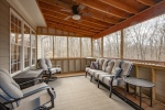 Enjoy the breezes on this screened in porch