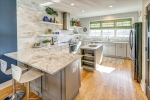 Light bright kitchen with granite and marble