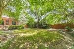 Mature trees give backyard lots of shade!