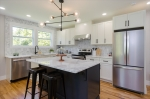 Huge kitchen island and quartz countertops