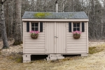 The shed offers additional storage space